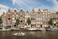 Amsterdam Canal Houses and boats Stock Photo