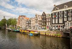 Amsterdam Canal Houses and boats Stock Images