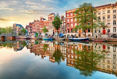 Amsterdam Canal houses vibrant reflections, Netherlands, panora. Ma stock images