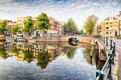 Amsterdam Canal houses vibrant reflections, Netherlands, panora. Ma stock photo
