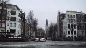 Amsterdam canal in ice. View from the boat stock video