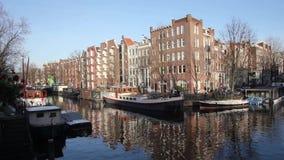 Amsterdam canal in Jordaan neighbourhood stock video footage