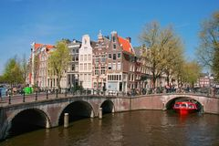 Amsterdam canal. Keizersgracht Leidsegracht with a red boat, Netherlands Royalty Free Stock Images