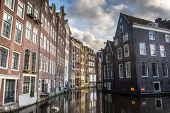 Amsterdam Canal. Canal in Amsterdam on a lightly cloud day Stock Images