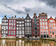 Amsterdam canal. Moody sky over 16th century homes along an Amsterdam canal Royalty Free Stock Photography