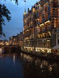 Amsterdam canal by night. Hotel and restaurant on Amsterdam canal at Stock Images