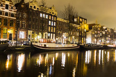 Amsterdam canal at night Stock Photography