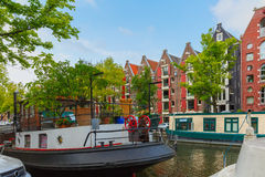 Amsterdam canal with picturesque houseboats Stock Photography