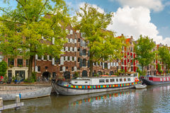 Amsterdam canal with picturesque houseboats Royalty Free Stock Photo