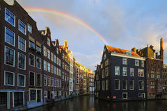 Amsterdam canal with rainbow Royalty Free Stock Photos