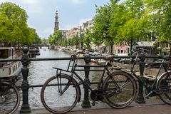 Amsterdam canal scene with bicycles and bridges. Holland stock photos