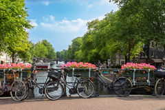 Amsterdam canal scene with bicycles and bridges Stock Photos