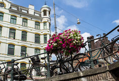 Amsterdam canal scene with bicycles and bridges. Holland royalty free stock photo