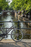 Amsterdam canal scene with bicycles and bridges. Holland royalty free stock image