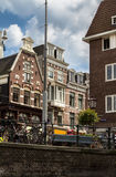 Amsterdam canal scene with bicycles and bridges. Holland royalty free stock images