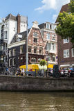 Amsterdam canal scene with bicycles and bridges. Holland stock images