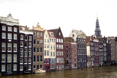 Amsterdam canal scene with old buildings and boat Royalty Free Stock Images