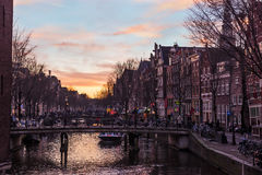 Amsterdam canal at sunset Stock Photography