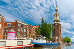 Amsterdam canal and tower Montelbaanstoren Holland Stock Images
