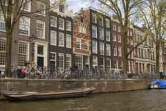 Amsterdam canal. Traditional Amsterdam canal houses in spring Stock Photos