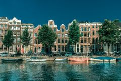 Amsterdam canal and typical houses, Holland stock photo