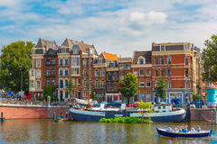 Amsterdam canal and typical houses, Holland stock images