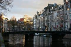Amsterdam Canal. A setting sun illuminates an Amsterdam canal Stock Image