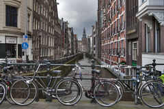 Amsterdam canal view, bicycles on the bridge. Stock Photo