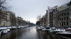 Amsterdam canal in winter. Winter scenery from the canals of Amsterdam Stock Photos