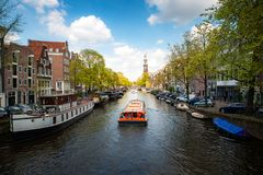 Free Amsterdam Canal With Cruise Ship With Netherlands Traditional House In Amsterdam, Netherlands. Landscape And Culture Travel, Or Royalty Free Stock Photography - 165870687