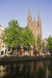 The Amsterdam canals. And typical houses on a blue sunny day royalty free stock photography