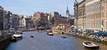 Amsterdam canals. Busy summer afternoon on Amsterdam canals, Amsterdam, Netherlands royalty free stock photos