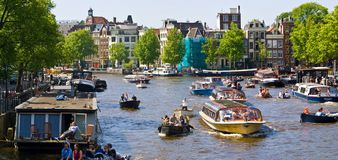 Amsterdam canals. Busy summer afternoon on Amsterdam canals, Amsterdam, Netherlands Stock Photos