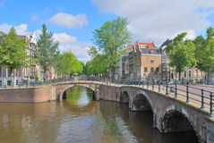Amsterdam canals. Amsterdam. Old buildings and bridges over canals and Keizersgraht and Regulirsgraht royalty free stock image