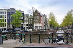 Amsterdam canals with bicycle Stock Photography