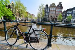 Amsterdam canals and bicycles Royalty Free Stock Image