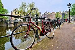 Amsterdam canals and bicycles Royalty Free Stock Photos