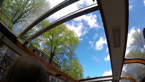 Amsterdam canals boat sunroof slow motion trip sky view stock video