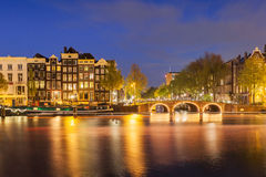 Amsterdam canals with bridge and typical dutch houses. Holland Stock Image