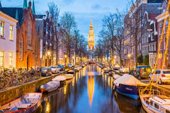 Amsterdam canals with bridge and typical dutch houses in Netherl Royalty Free Stock Images