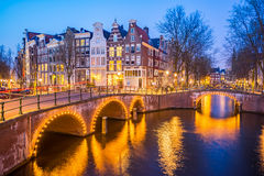 Amsterdam canals with bridge and typical dutch houses in Netherl Stock Photography