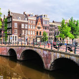 Amsterdam canals. Canal houses and bridge along the canals of Amsterdam, Netherlands Royalty Free Stock Images