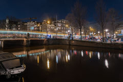 Amsterdam canals at night Stock Images