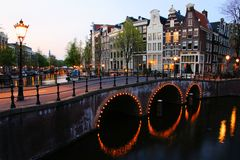 Amsterdam canals at night. Amsterdam canals lit up at dusk, Netherlands Stock Photo