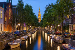 Amsterdam canals. Traditional view of canals in Amsterdam where boats, bicycles and cars on same street stock photo