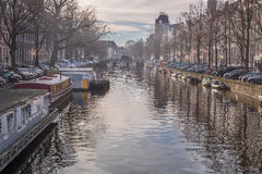 Amsterdam canals in winter. Amsterdam, has more than one hundred kilometers of canals, about 90 islands and 1,500 bridges. The three main canals, Herengracht stock images