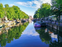 Amsterdam Cannal with a beautiful water reflection Stock Photos