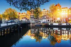 Amsterdam is the capital and most populous city in Netherlands. Amsterdam canal at sunset. Amsterdam is the capital and most populous city in Netherlands Royalty Free Stock Photography