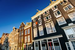 Amsterdam is the capital and most populous city in Netherlands. Amsterdam canal at sunset. Amsterdam is the capital and most populous city in Netherlands Stock Images