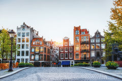 Amsterdam is the capital and most populous city in Netherlands. Scenic houses at sunset Royalty Free Stock Photo